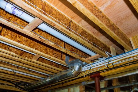 Interior wall framing electric with piping and wiring installed in the basement of house under remodeling