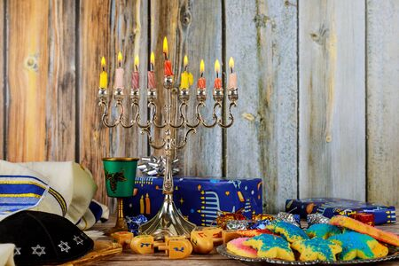 Closeup of a burning Chanukah candlestick with candles Menorah a traditional Jewish holiday Zdjęcie Seryjne