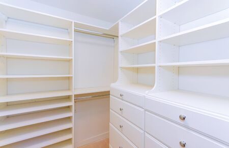 Furniture installation of shelves with new apartment a shelf new home construction of interior room Stock Photo