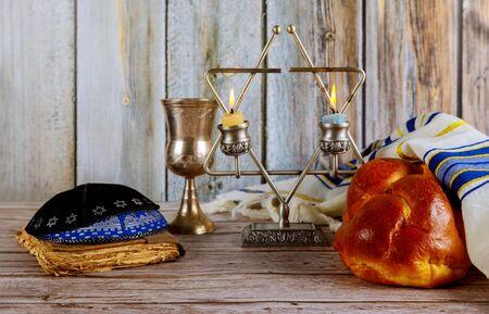 Sabbath Jewish Holiday homemade sesame challah bread and candelas on table Stock fotó