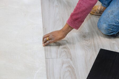 Repair of the floor installation of laminate strips linoleum with new home improvement Stock Photo