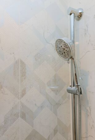 New home shower head in modern bathroom with construction Stockfoto