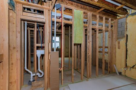 Under construction new home construction pipes and electrical unfinished basement 스톡 콘텐츠