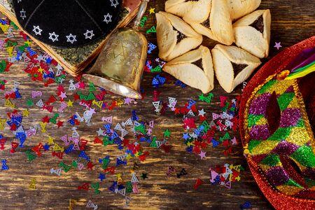 Traditional jewish carnival holiday Purim celebration and cookies hamans ears, and mask, kippa Stock Photo