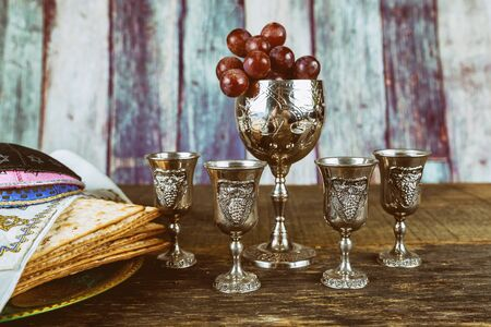 Jewish holiday Passover with matzah, pesah celebration four cup kosher wine