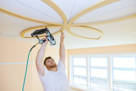 Installing ceiling moldings in the interior handyman using gauge finish nailer decorative ceiling molding