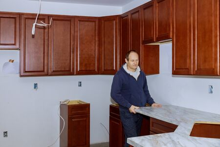 Installing laminate kitchen counter top a kitchen remodel.