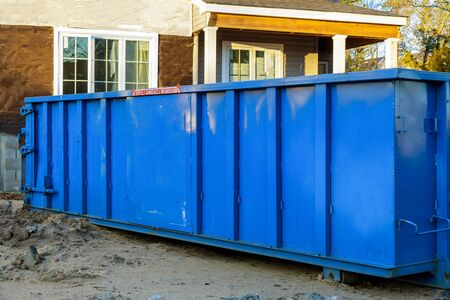 Trash dumpsters a large container filled with industrial garbage bin Stock Photo