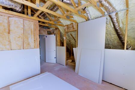 Construction materials plasterboard drywall are prepared for working process installing HVAC vents being installed