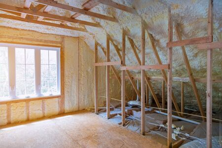 Thermal insulation a new house under the roof of air conditioner vents in new home construction on the roof Stock Photo