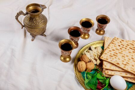 Jewish pesah holiday matzoh unleavened bread with kiddush four cup of wine