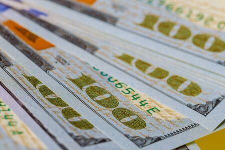 Close up of new hundred dollar bills pile