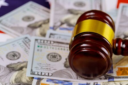 Law hammer judge and dollars on wooden table close up corruption, money financial crime Stock Photo