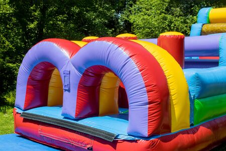 Funny off kids in the plays in an castle inflatable slides