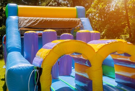 Jumps on a big inflatable trampoline castle labyrinth