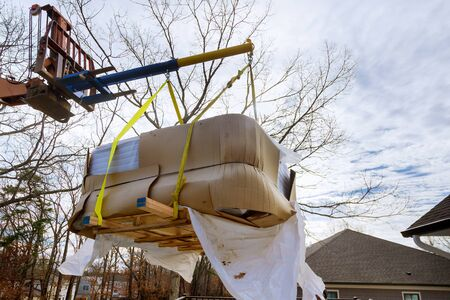 Lifting Boom Lift in modern jacuzi are lifting by boom crane truck