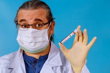 Doctor in face mask a blood test 2019-nCoV atypical pneumonia virus coronavirus with blood sample