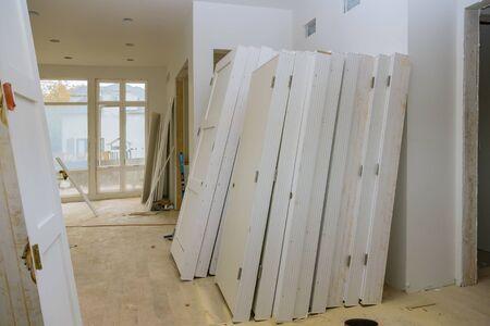 Door installed construction materials with interior construction of housing project Standard-Bild