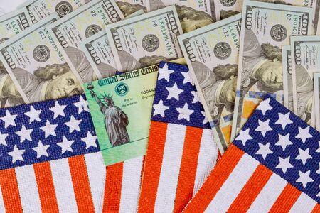 Senate stimulus deal includes individual checks USA dollar cash banknote on American flag Global pandemic Covid 19 lockdown