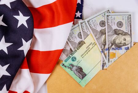 Congressional lawmakers are putting the finishing touches on a stimulus bill US 100 dollar bills currency on American flag Global pandemic Covid 19 lockdown