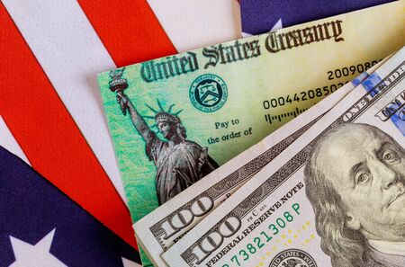 COVID-19 on global pandemic lockdown, stimulus package financial package government for people, US dollar cash banknote on American flag