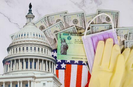 Senate stimulus deal includes individual checks virus economic stimulus plan USA dollar cash banknote on American flag Global pandemic Covid 19 lockdown Banque d'images