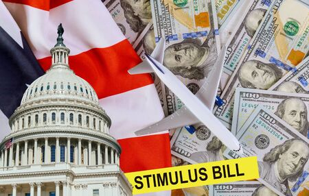 Senate stimulus deal financial assistance to air carriers econo mic stimulus plan USA dollar cash banknote on American flag Global pandemic Covid 19 lockdown