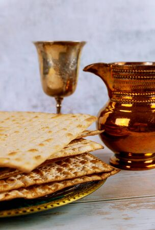 Jewish Passover holiday celebration, matza unleavened bread and cup kosher wine Stock Photo
