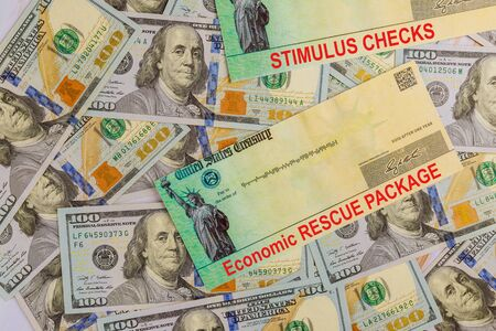 Economic Stimulus Bill Financial a stimulus bill individual checks from government US 100 dollar bills currency on American flag Global pandemic Covid 19 lockdown