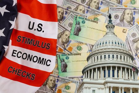 U.S. Economic STIMULUS CHECKS Bill Coronavirus Global pandemic Covid 19 financial lockdown from government US 100 dollar bills currency on American flag