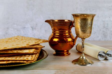 Passover holiday Jewish Pesah celebrating, matzoh and traditional seder plate Stock Photo