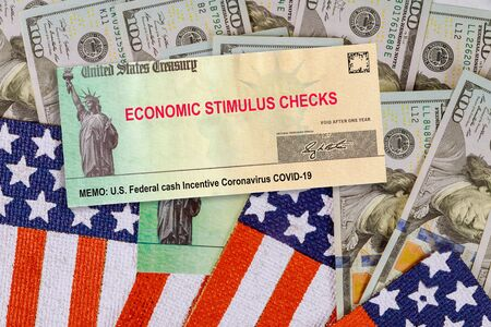 Financial Federal STIMULUS Coronavirus Global pandemic Covid 19 lockdown financial relief checks from government US 100 dollar bills currency on American flag