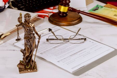 Justice statue with office consultation of lawyers professional of Judge gavel with scales of justice. 版權商用圖片