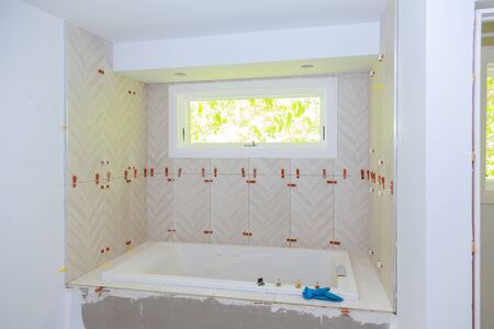 Construction installing ceramic tile on reconstruction of bathroom during or renovation
