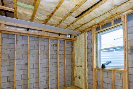 Underground under construction of basement foam for thermal insulation of walls wooden house