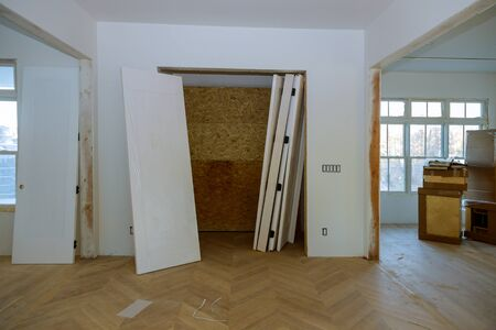 Unfinished house where wooden interior doors a wait installation a new apartment built Stock Photo