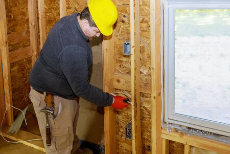 Electrical wiring in walls of new home construction has several outlets