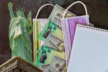 Global pandemic Covid 19 lockdown on Senate stimulus individual checks USA dollar cash banknote
