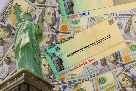 Economic government relief Word COVID-19 on global pandemic on financial lockdown from government US 100 dollar bills currency