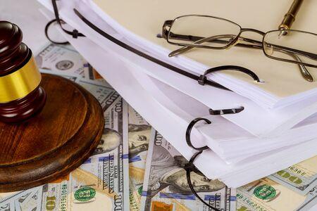 Workplace legislation office judge's gavel symbol on file folder with law documents