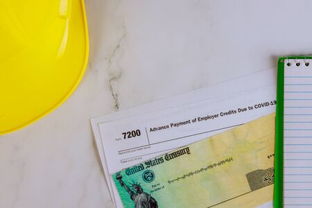 Applying for a About Form 7200 Advance Payment of Employer Credits Due to COVID-19 Loan and Coronavirus Tax Relief check Standard-Bild