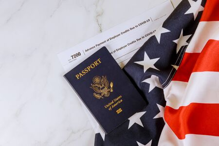 American flag, Form 7200, Advance Payment of Employer Credits Due to COVID-19 on Passport of US
