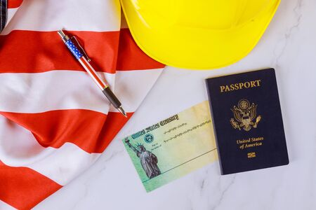 American flag on Stimulus financial relief check to the Passport of USA in yellow hard hat