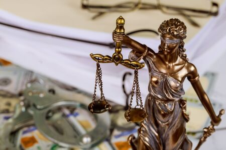Figure Justice holding the scales of justice with lawyer working on documents Standard-Bild
