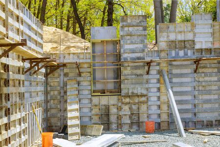 Formwork, which is prepared for pouring the foundation house under construction. Standard-Bild