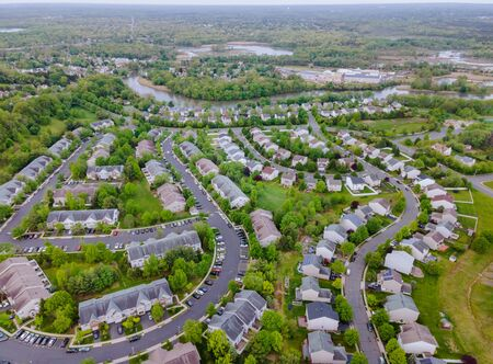 A small town from a height suburban neighborhood with roofs of houses urban landscape