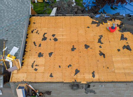 Removal of old roof and replacement with all new shingle being applied home roof construction