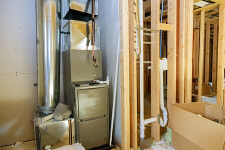 New home construction with installation of heating system in basement of house under remodeling Standard-Bild