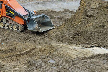 Earth moving equipment at new development bulldozer earthmoving dozer is moving soil is leveling the land Standard-Bild