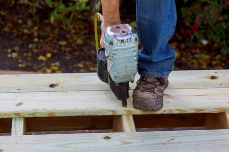 Installing wood floor for patio deck with new wooden decking fragment planks